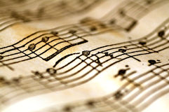 Notas onduladas da música Fotografia de Stock Royalty Free