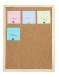 Notas pegajosas coloridas no quadro de mensagens/original/cópia/cance da cortiça Foto de Stock
