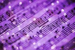Notas violetas de la música imagen de archivo libre de regalías