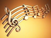 Notas y clave de sol de oro de la música en secuencias musicales en amarillo Fotos de archivo