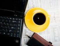 Notatnik, filiżanka kawy Zdjęcie Stock