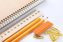 Notatnik, gumka, władca, ołówek i paperclips, Obraz Stock