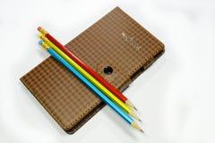 Notatnik i ołówki Zdjęcie Stock