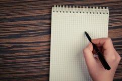 notatnik kobieta pisze Fotografia Royalty Free