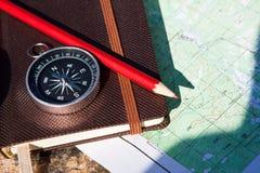 Notatnik, kompas, ołówek na kamiennym tle zdjęcie royalty free