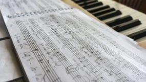 Notatnik z muzycznymi notatkami Obraz Royalty Free