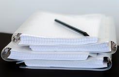 Notatniki i czarny ołówek Obraz Royalty Free