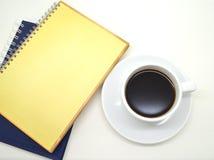Notatniki i filiżanka kawy Obrazy Royalty Free
