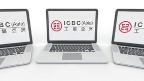 Notatniki z Przemysłowym i Commercial Bank Porcelanowy ICBC logo na ekranie Informatyka konceptualny artykuł wstępny Fotografia Royalty Free