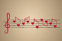 Notblad med hjärta formade musikaliska anmärkningar Royaltyfria Foton