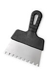 Notched trowel with a black handle on a white background Royalty Free Stock Photo