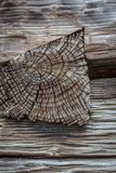 Notched wood joint showing end grain in hand hewn beams. Horizontal aspect Royalty Free Stock Photo