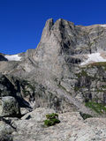Notchtop Mountain in Rocky Mountain National Park. Blue skies over the peak of Notchtop Mountain on a summer day Stock Photo