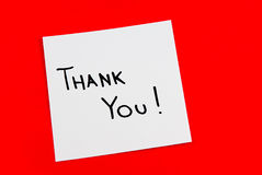 Note. Thank you note isolated on red background Royalty Free Stock Image