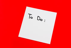 Note. To do note isolated on red background Royalty Free Stock Photography