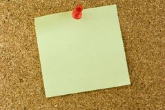 Note. A note stuck to a cork board with a push pin Stock Photo