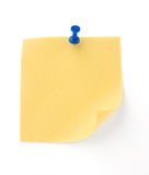 Note. Yellow note with blue pin over white background royalty free stock images