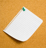 Note. Page from note pad pinned to cork pinboard Royalty Free Stock Photos