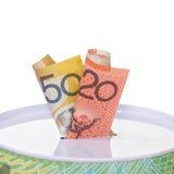 Note australiane farcite dentro ad una latta dei soldi Fotografia Stock