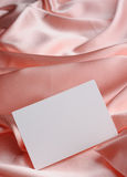 Note on beige silk Stock Image