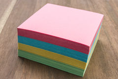 Note Block Closed. A Still Life of of a Post Note Block.  The Block has Yellow Blue, Pink and Green paper Royalty Free Stock Photo