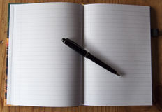 Note Block with pen Royalty Free Stock Photos