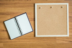 Note and board on wood texture background royalty free stock photography