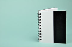Note book. Standing note book on green background royalty free stock image