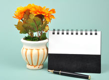 Note book. And pen on green background stock photos