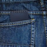 Note book in a back pocket of a jeans Stock Photo