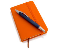 Note book with ballpoint pen Stock Images