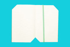 Note book on blue background isolated royalty free stock photography