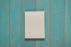 Note book on blue wooden desk. Top view Royalty Free Stock Photography