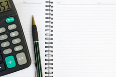Note book with calculator and pen Royalty Free Stock Photography