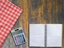 Note book and calculator with red napkin Stock Photography