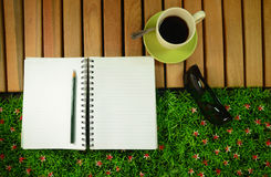 Note book and coffee Royalty Free Stock Photo