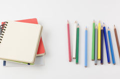 Note book and colored pencils. Stock Photography
