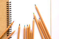 Note book and colored pencils Royalty Free Stock Photography