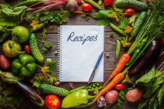 Note book and composition of vegetables Stock Photos