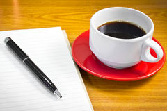 Note book and cup of coffee Royalty Free Stock Photos