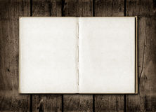 Note book on a dark wood background Royalty Free Stock Photos