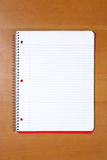A note book on a desk. In an office Royalty Free Stock Photo