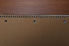 Note book on desk. Of wood Stock Photo
