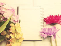 Note book diary and beautiful flower bouquet with vintage filter Stock Images