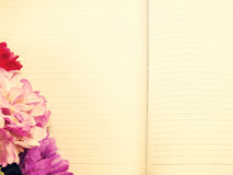 Note book diary and beautiful flower bouquet with vintage filter Stock Photography