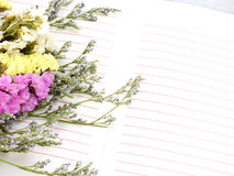 Note book diary and beautiful flower bouquet with vintage filter Stock Photo