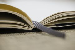 Note book with fabric bookmark stock photo