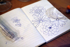Note book with flowers drawing Royalty Free Stock Photography