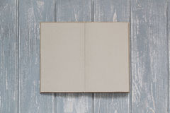 Note book on grey wooden desk. Top view Royalty Free Stock Photos