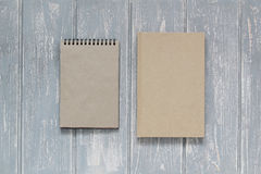 Note book on grey wooden desk. Top view Stock Photography